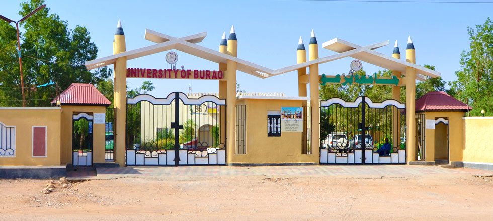 The archway of the main entrance of the University