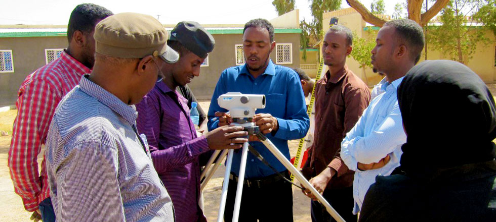 Civil Engineering Students Practicing Surveyor